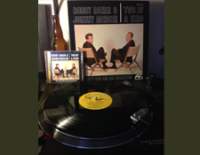http://audiophilereview.com/images/BobbyDarinJohnnyMercerPlaying225.jpg