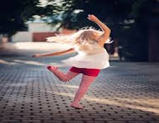 Girl-Dancing-On-Sidewalk.jpg